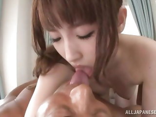 This sexy Japanese babe lays back and opens her legs so her man can taste that amazing pussy of hers. She sits on his face. She enjoys getting her cun