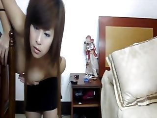 Hot Korean girl in a sexy black mini dress is exposing her young firm tits. Very seductive, very teasing webcam show from her bedroom. What's eve