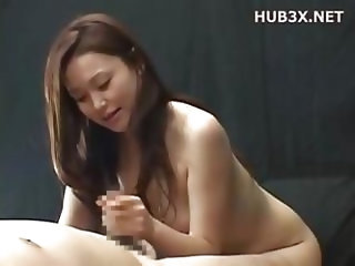 Cute Asian girl gives him a handjob in POV and sucks a bit too