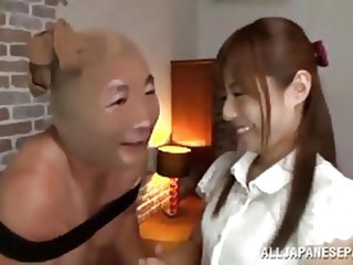 Sexy and dominating milf Rina has her man right where she wants him. The dirty girl has pantyhose put on her slave's head and she kicks him squar