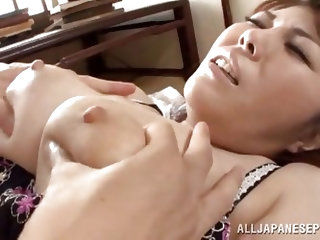 This brunette Japanese milf wants to please her husband. He squeezes her massive melons and then, slaps his dick on her tits. Watch, as she gives an a