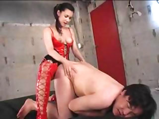 Hot Asian dominatrix uses a strapon to fuck this dude's ass