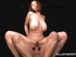 The Japanese slutty milf with big, amazing tits in the video, is very sensual and horny. She's sompletely naked and the camera catches nice close