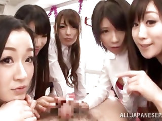 These cute Japanese schoolgirls have their teacher right where they want him. They rubs their shoes all over his body including his nipples and crotch