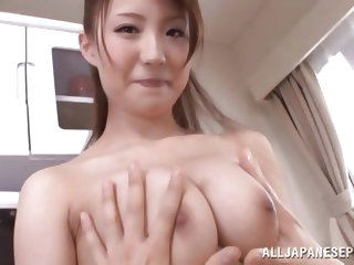 This Japanese lady has a massive pair of breasts, and she want to show them off to everyone. She takes off her shirt and lets her man grab a handful o